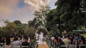 Couple wed in front of spewing volcano