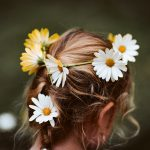 A punk rocker with flowers in her hair