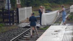 Newlyweds under fire for posing on train tracks