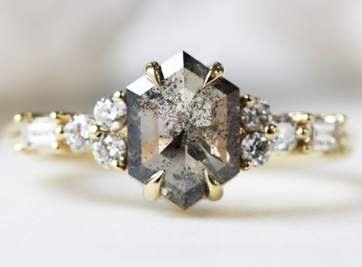 Gothic-inspired rings for the bride with an edge