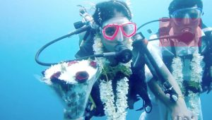 Couple marry in what may be the first traditional Hindu underwater wedding